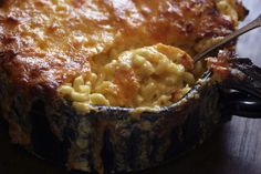 Creamy Macaroni and Cheese - nothing more than tender elbows of pasta suspended in pure molten cheddar, with a chewy, golden-brown crust of cheese on top.
