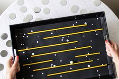 With star details and bright yellow accents, this fun DIY creates a fun maze game for the whole family to enjoy!