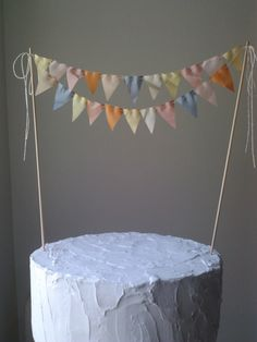 Cake Bunting Flags Wedding Cake Topper -Spring- pale yellow, melon, dove grey, pink. $22.00, via Etsy.