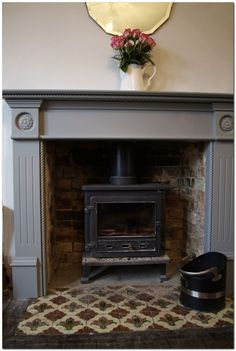 5 Dumbfounding Diy Ideas: Freestanding Fireplace On Bench painted fireplace insert.Small Limestone Fireplace free standing fireplace remodel… – for our new home Wood Burner Fireplace, Paint Fireplace, Small Fireplace, Fireplace Hearth, Fireplace Remodel, Fireplace Surrounds, Fireplace Ideas, Black Fireplace, Wooden Fireplace Surround