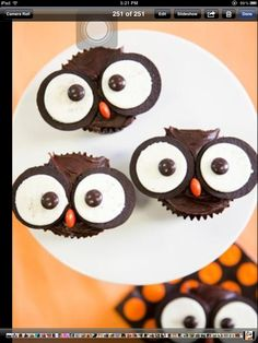halloween owl cupcakes, topless oreo eyes, m&ms pupils, resees pieces mouth!