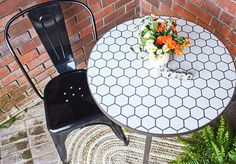 Farmhouse style outdoor seating area, decorated with stylish Better Homes & Gardens products from Walmart, including a mosaic tile top table & metal chairs. | #sponsored by BHG at Walmart #ad