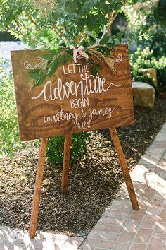 wedding signs - photo by The Edges Wedding Photography http://ruffledblog.com/romantic-destination-wedding-in-napa-valley