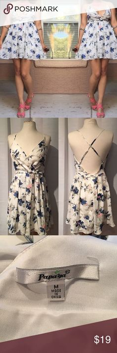 Floral Printed Spaghetti Strapped Dress Used Only Once - Floral Printed Spaghetti Strapped Dress from Papaya Clothing Dress: - White with floral printed blue and pink - Adjustable Straps - Size Medium * Original Price: $29.99 Thank you. Papaya Dresses Mini