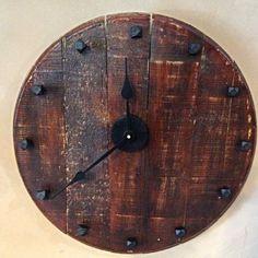 Whiskey barrel lid/head made into clock.