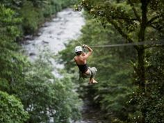 Arenal Paraiso Ziplines Canopy in Costa Rica ~ this zipline canopy tour has 12 platforms and goes over the Arenal River.  It is one of the best zipline tours in Costa Rica.  Arenal Paraiso Canopy Tour is located just behind the Arenal Paraiso Resort Hotel in La Fortuna.  135km from Atenas, it is about 2hr 30min away by car.