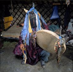 Mongolian shaman healer... drummer - beautiful photo....