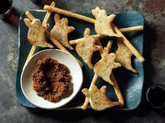 This ghost-shaped crostini--Ghostinis--make an eerie accompaniment to this tomato tapenade.