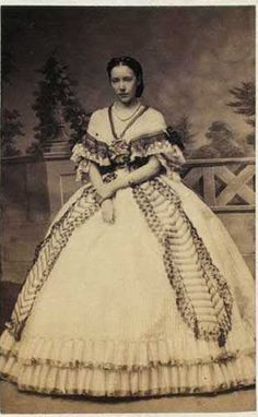 Fashion photographs   Fashion images, fashion photos. A gorgeous gown clearly supported by a crinoline below.