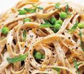 Creamy Fettuccine With Peas and Basil: Recipes: Self.com : Satisfy a hankering for high-fat Alfredo sauce with this light, no-dairy version. Oat milk and cashew butter stand in for heavy cream, keeping calories and saturated fat low. via @SELF Magazine