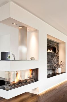 Who needs a living room wall when he has such a beautiful panoramic gas fireplace with modern stone paneling and white plaster. Who needs a living room wall when he has such a beautiful panoramic gas fireplace with modern stone paneling and white plaster. Home Fireplace, Modern Fireplace, Fireplace Design, Fireplaces, Fireplace Ideas, Ethanol Fireplace, Elegant Home Decor, Elegant Homes, Style At Home