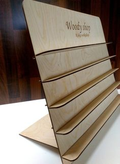 This listing is for wooden jewelry stand with your engraved logo or name. This is very nice gift for your shop!!!  * Item details: Height: 33,5 cm ( 13.1 Inches) Width: 40 cm (15.7 Inches) Size between shelves: 5 cm ( 1.9 Inches) Shelf width: 3cm ( 1.1 Inches) * Write in the note to seller your: Name, or send me your shop logo  * Materials: wood.  * I love doing custom orders, so convo me and I will do best to get you exactly what you need.**  Thanks for visiting my shop