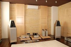 Listening room with light colored wood paneling.