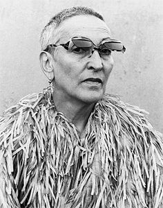 Meret Oppenheim in paper coat and sunglasses designed by herself, 1976. Collection Dominique Bürgi, Switzerland Claude Lê-Ahn, Boulogne    Oppenheim worked as a model and as a designer of jewellery and clothes. Some of her designs were sold in the 30ies to the famous Paris designer Elsa Schiaparelli.