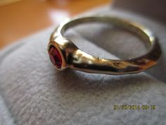 Unusual gold hammered band red spinel ring by MoInKiBeadDesigns, $38.00