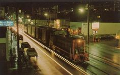 Freight train heading east along Route 66 (Santa Monica Blvd., West Hollywood) making its last midnight run on a rainy night in January, 1971 (from Carl Gottlieb to Vintage Los Angeles)
