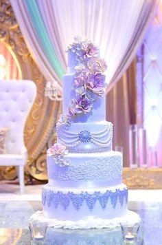 Elegant white on white wedding cake with beautiful design.