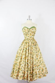 bridesmaid dresses!?!  her colors are sage and yellow.  LOVE LOVE LOVE this print!    1950's Vintage Dress - Strapless Polished Cotton Green and Golds Floral Print Circle Skirt Party Dress