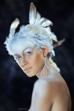 White Swan  by Mikaella Speranskaya  I love that she's painted white, and the headdress just flows into (or out of) it.