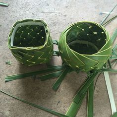 Two Palm frond baskets 12 leaves each one round one square.