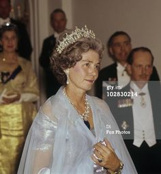 London 1963. Queen Frederica of Greece (née Hanover) wearing the great tiara inherited from her mother-in-law Queen Sophie and a huge 438 carat sapphire suspended from a diamond and pearl necklace. Princess Frederica of Hanover married her first cousin once removed (she was a great-niece of King Paul's mother Sophia).