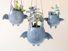 The handmade flying bat hanging plant holder gives you a cute way to hold your favorite succulents, and it will never take up any surface in your room. Hanging Bat, Hanging Vases, Hanging Plants, Keramik Design, Cute Bat, Goth Home, Plant Holders, Clay Crafts, Clay Art