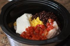 Bag of frozen chicken in the crock pot. Put the cream cheese, corn, salsa and black beans on top and let it go for 6-8 hours on low. shred when done. serve with chips or as tacos. (This is super awesome, I make it a lot).