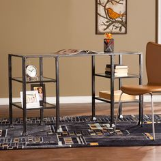 Double the workload, double the space. Give your office a new angle on organization with this sleek, minimalist desk. Effortlessly linear, the distressed black frame cures the clutter with four shadowbox shelves. Quietly playful, trilateral feet