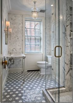 Small but precious. The continuous floor tile and expansive glass make this room light and airy.