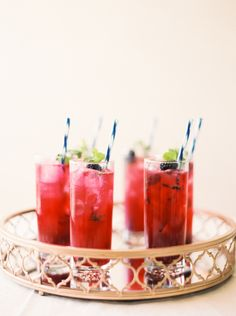 Hawaiian Blackberry Mojitos: http://www.stylemepretty.com/2015/08/18/signature-wedding-cocktails-in-10-shades-of-pink/