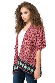A dreamy lightweight kimono, featuring a Moroccan-inspired tiled pattern throughout with contrast trim. Woven. Half-length Dolman sleeves. Slit sides. Open front. Marrow finish hem. $22.50