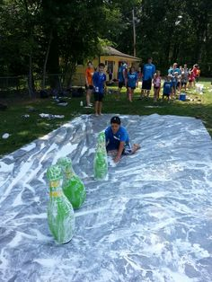 July 22 shaving cream slip and slide bowling. Campers tried to get strikes using there body to get strikes during slip and slide bowling.