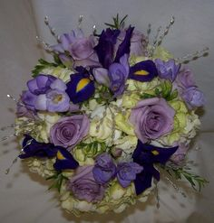 Hand-Tied Bouquet Featuring Hydrangeas, Roses and Irises