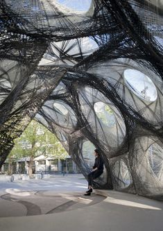 Biomimicry in Architecture: carbon fiber pavillion whose geometries are based on structural principles abstracted from the beetle elytra. Each of them has an individual fiber layout which results in a material efficient load-bearing system. The biggest element has a 2.6 m diameter with a weight of only 24.1 kg. The research pavilion covers a total area of 50 m² and a volume of 122 m³ with a weight of 593 kg //