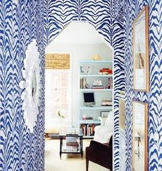 heavily patterned wallpaper for a little hallway  - love this