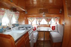 Vintage travel trailer dining room. Very simple, but beautiful too! I love this since it has my Dads initials!... I miss him so much!