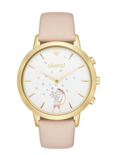 Hybrid Smart Watch | Kate Spade New York | track your steps, sleep and other habits, set personal goals, count down to life's merriest moments (big and small!) and get inspired every single day. your watch alerts you with vibrations, controls music, automatically updates time zones, takes selfies and never needs charging—and, with a vachetta leather strap, gold-tone case and classic white dial (with champagne glasses spouting crystal bubbles at the six o'clock index), it's as chic as it is…