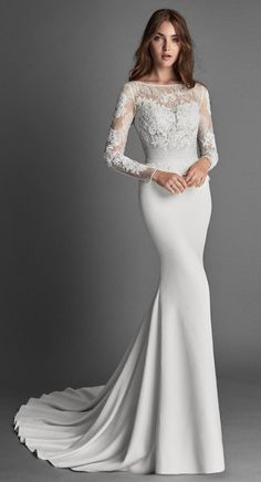 2018 Alma Novia Collection REFLEJO Mermaid-style crepe and lace wedding dress wi… 2018 Alma Novia Collection REFLEJO Mermaid-style crepe and lace dress with long sleeves, bateau neckline, low back and beadwork detail, in natural. Elegant Wedding Dress, Dream Wedding Dresses, Bridal Dresses, Wedding Gowns, Kebaya Wedding, Wedding Ceremonies, Wedding Bouquets, Bridesmaid Dresses, Boho Vintage