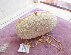 Embroidered Pearl Clutch