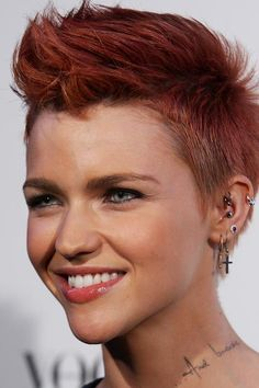 Ruby Rose lets a little punk vibe sneak through with her faux hawk and acid orange color.