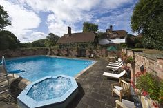 An outdoor walled swimming pool complex in English standstone, with a jacuzzi was added by current ownersVic Fatah, 68, a retired travel entrepreneur, and his wife Lyn, 62