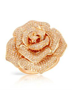 Rose made of rose gold and diamonds. So gorgeous.