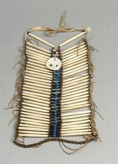 Plains Hairpipe Breastplate | c. late 19th century | Four strips of commercial leather, hide-strung bone hairpipes and multicolored glass trade beads, and a glass bead and shell disc pendant | 1,058$ ~ Sold