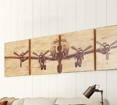 "Our portrait of a four-engine plane celebrates the golden age of aviation in sepia tones. Crafted of fir that is detailed with natural imperfections and splits in the wood, this artwork has a timeworn, rustic feel. Features: Backed with D-rings for mounting. Overall: 96"" wide x 24"" high x 2"" thick Individual Square (4): 24"" square, 2"" thick Printed onto planked fir wood. Each set includes four squares. This product is hand finished and distressed so each will have a unique finish. Please…"