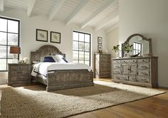 A scalloped shape arched headboard and shaped footboard with raised trim adds feminine styling to this rustic pine bed. Its weathered gray over rustic salvaged pine solid wood makes it an impressive focal point for your master bedroom. The rough hewn wood and variation in the finish has a casual and inviting appeal.