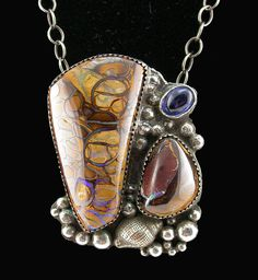 Necklace | Laur Pacino. 2 Koroit Opals, Kyanite, sterling silver and bronze clay.