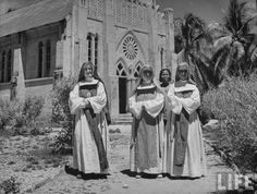 Australian nuns of the Order of the Sacred Heart stand outside church; they refused to leave during the Japanese occupation -1944