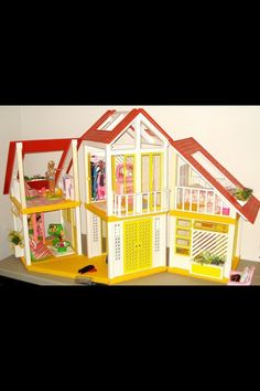 """Barbie Dream House- my fave toy ever!! Had same couch and called it """"the bubblegum couch"""" cuz the colors reminded me of fruit stripes gum!!"""