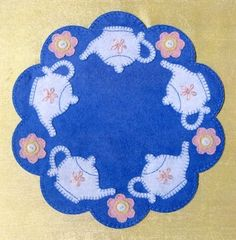 Teapot candle mat - could use read back ground, white tea pot and Blue stars