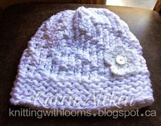 Today I wanted to share the finished hat I made for my cousin. She requested a white hat with a white flower.  It was knit in the round, us...